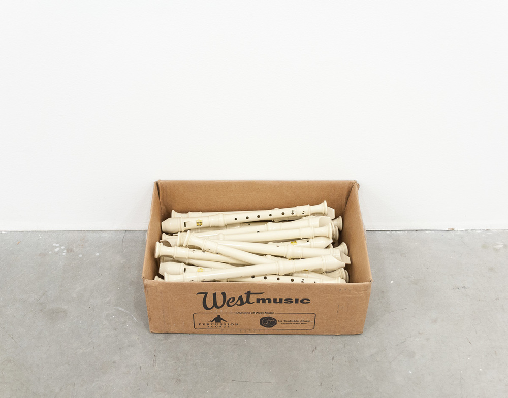"Derek Franklin  Communal Wind  A box of thirty recorders filled with spit 14"" x 18"" x 4"" 2015"