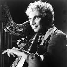 Harpo Marx.  Image via  biography.com .