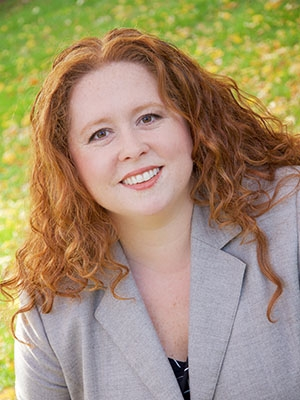 "Alexis Ganter, Manager of Client Relations - Alexis has managed projects and accounts for national print magazines (Rolling Stone and Men's Journal), broadcast television, and nonprofit agencies. She creates marketing value through creative messaging, inspired design, and user experience that speaks to your unique brand. Alexis's years as a news producer drive her interest in the ""real story"" behind your marketing needs, which makes coming to work every day a passion project vs. just a job. A graduate of SUNY Geneseo with a degree in mass media and public relations, she brings her more than 15 years of experience in negotiating and coordinating the many details of a full marketing campaign to work for our clients — making sure its your best impression everyone is talking about! When Alexis is reading blogs obsessively while telling her husband she's folding laundry and she's also watching television for the commercials, not the shows."