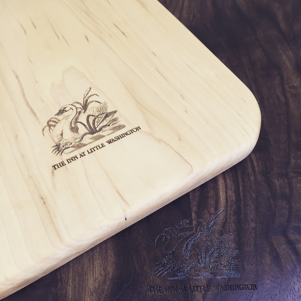 The Inn At Little Washington custom cutting boards with laser etched Logo