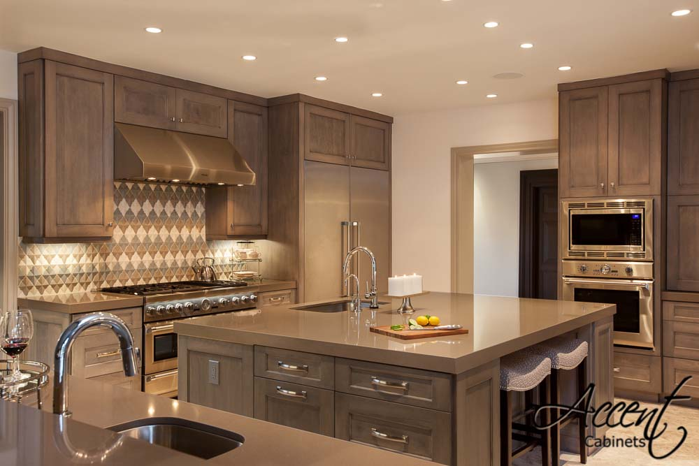 Transitional   Transitional kitchen with gray shaker doors and coordinating island.  Project location:  Houston, TX