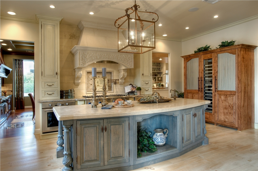 Traditional   This gorgeous Country French kitchen features raised panel doors painted French Cream with brown glaze finish.  The island is French Blue with Whitewash glaze.    Project location:  Houston, TX