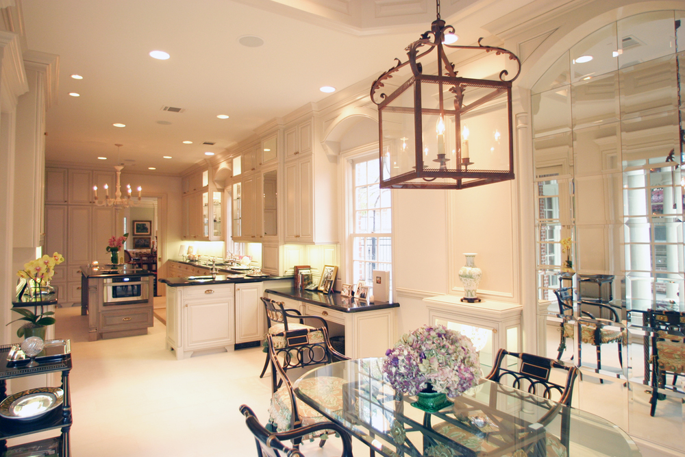 Traditional   This elegant traditional kitchen features a stained maple island, painted cabinets, and mirrored door panels.  Project location:  Houston, TX