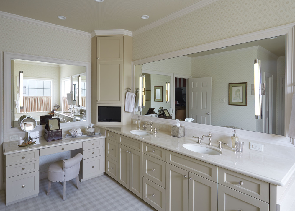 Transitional   Beautiful transitional bathroom features painted shaker door fronts.