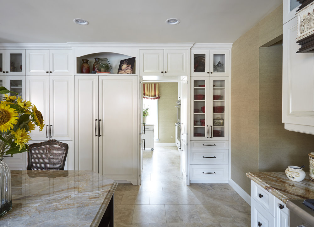 Transitional Kitchen with Hidden Pantry   This gorgeous transitional kitchen features exceptional craftsmanship and function - painted cabinets, stained island, and a door leading to a hidden pantry.    Project location:  Houston, TX