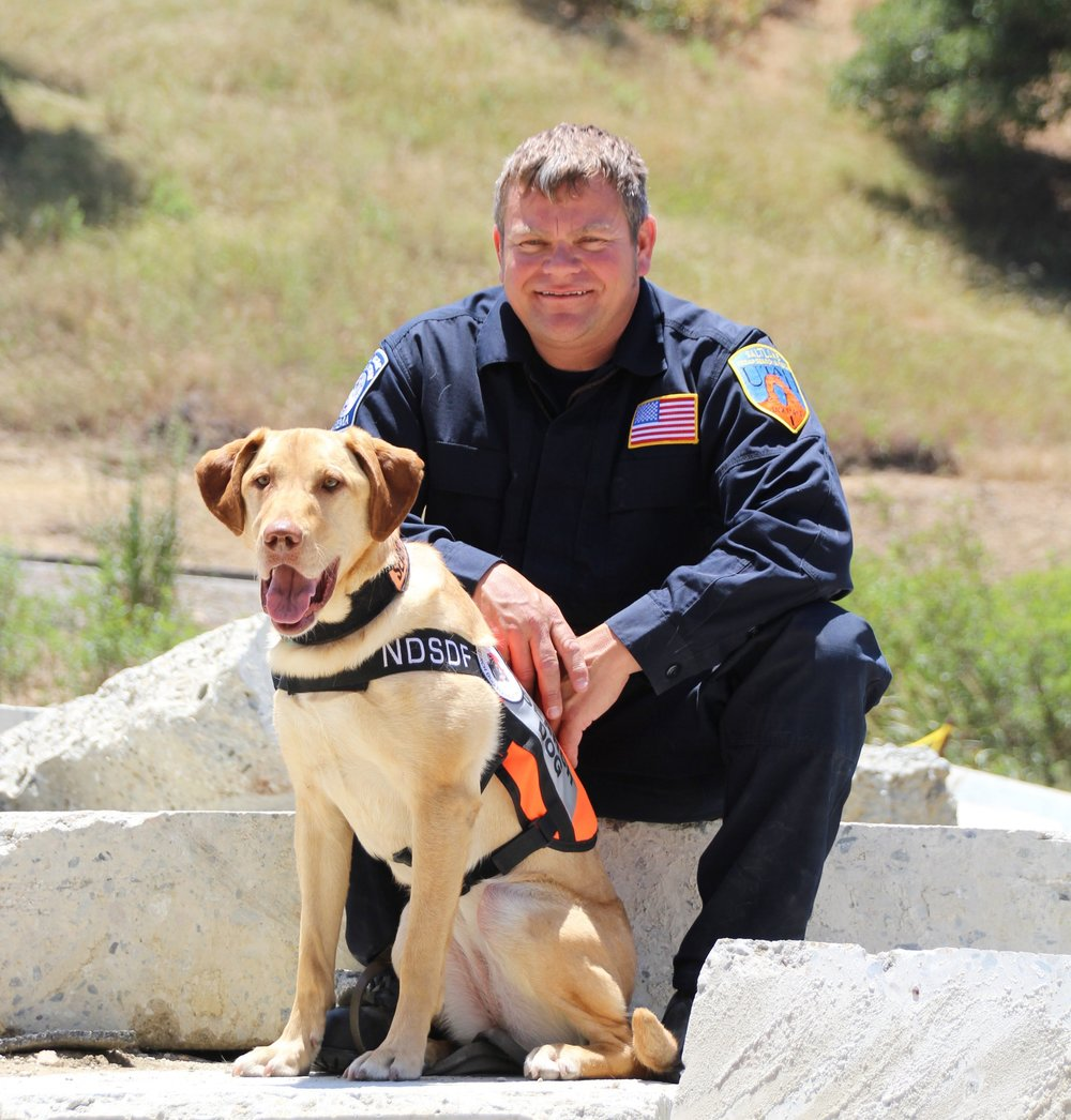 GIVING BACK - We internalize and live the mission of fortifying our nation - and that doesn't stop at the end of the workday. We invest our time, our money, and ourselves into our communities. With our love of dogs and our passion for the mission, we have established a strong partnership with the National Disaster Search Dog Foundation. #welovedogs