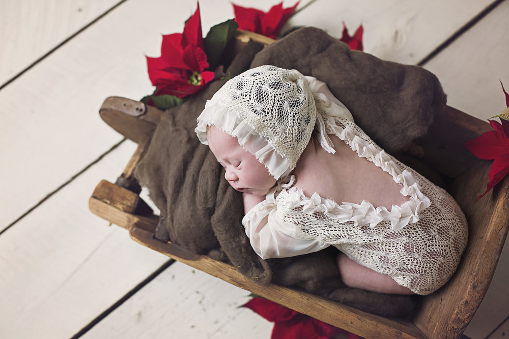 """""""Our newborn session with Lindsey was amazing!!! She is so very patient, caring & loving. The session was actually very calm & relaxing for me- much needed with a 2 week old. Our photos turned out amazing, including our little family photos. I would highly recommend Lindsey!"""" - Jenn O'Neal"""