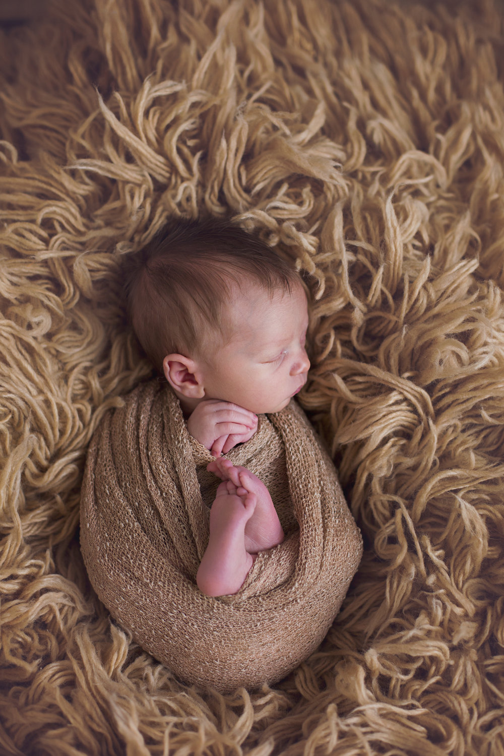 """""""Lindsey did such an amazing job with our little one!! She worked magic and captured some beautiful photos of our little man. Not only is she a great photographer but a great person and we had so much fun! I would recommend her to anyone!"""" - Brittany Curry"""
