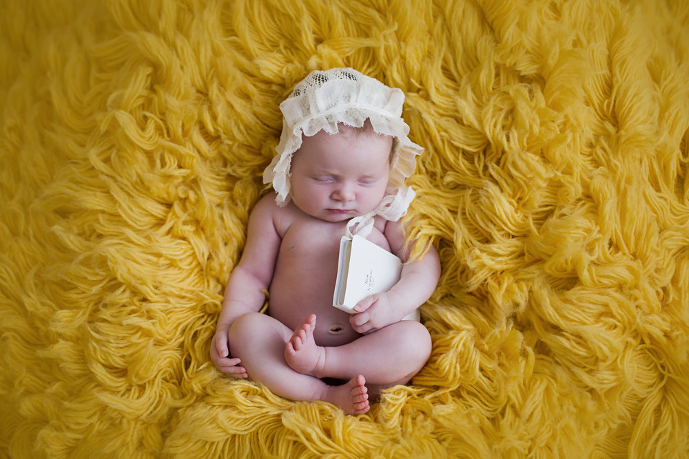 """""""This is the second time I have used Lindsey. She does amazing work and is so good with our daughter Ava getting her to smile. Looking forward to my newborn session with her and many more sessions in the future!!!"""" - Sharah Benton"""