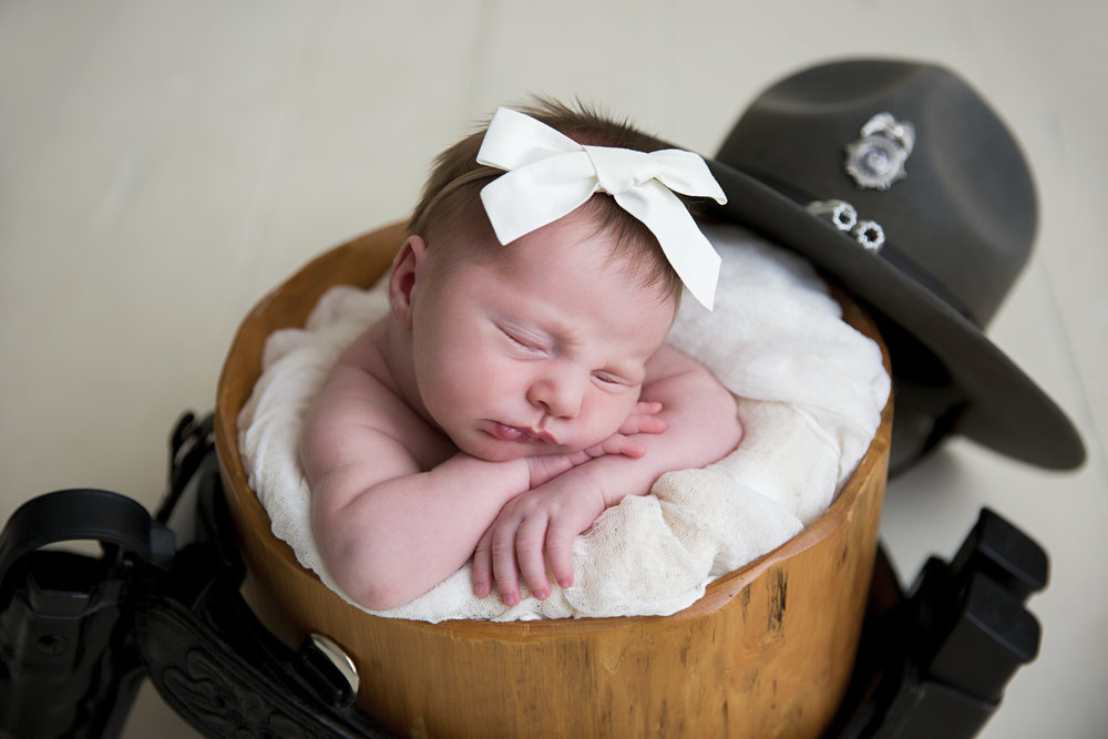 """""""Lindsey did newborn pictures for us. She was so patient to get the perfect shot of both baby and my 3year old. We will definitely use her again!""""  - Lauren Ault"""
