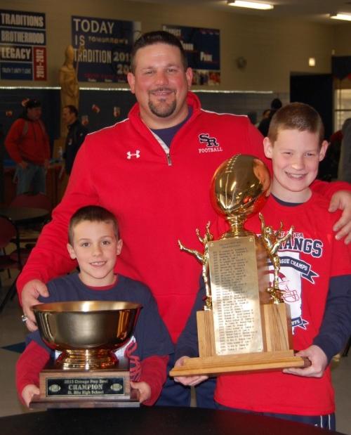 St. Rita High School Head Football Coach Todd Kuska '90 with his sons Joey (left) and Jake.