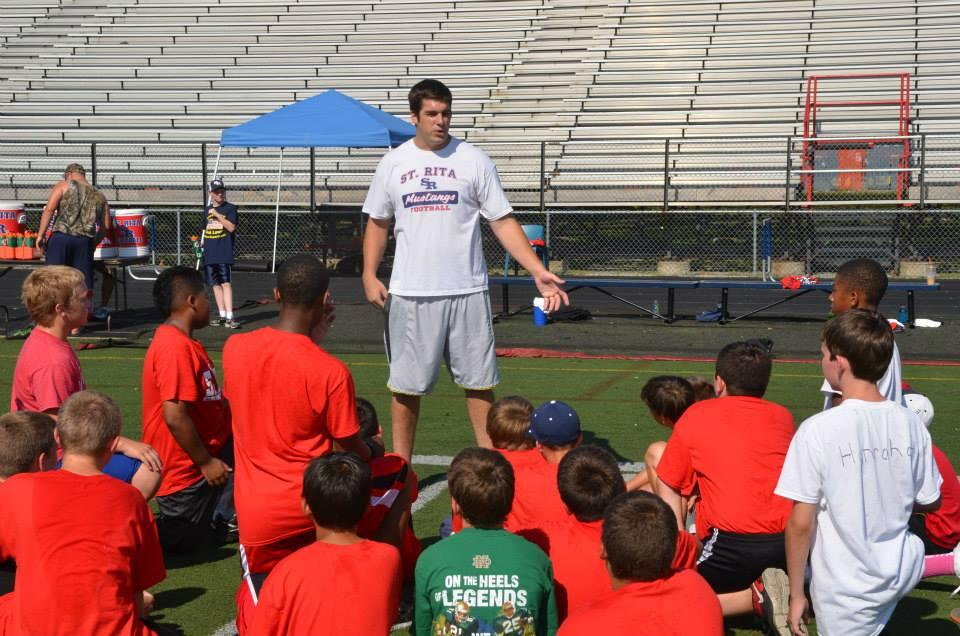Matt Conrath '07 teaches future Ritamen at a St. Rita High School Football Summer Camp