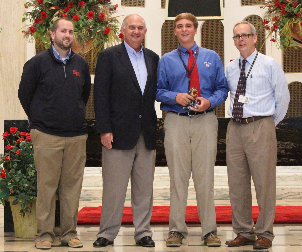 L to R: Josh Blaszak '04,Director of Student Life & Ministry; Ernie Mrozek '71, President;  TJ DeCesare,Junior Mustang of the Month; Brendan Conroy, Principal