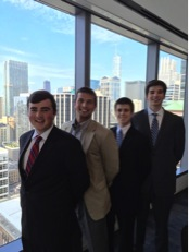L to R Teddy McDermott, Nick LoMaglio '04, Collin Rook and Connor Healy at the UBS Financial Services office in downtown Chicago.