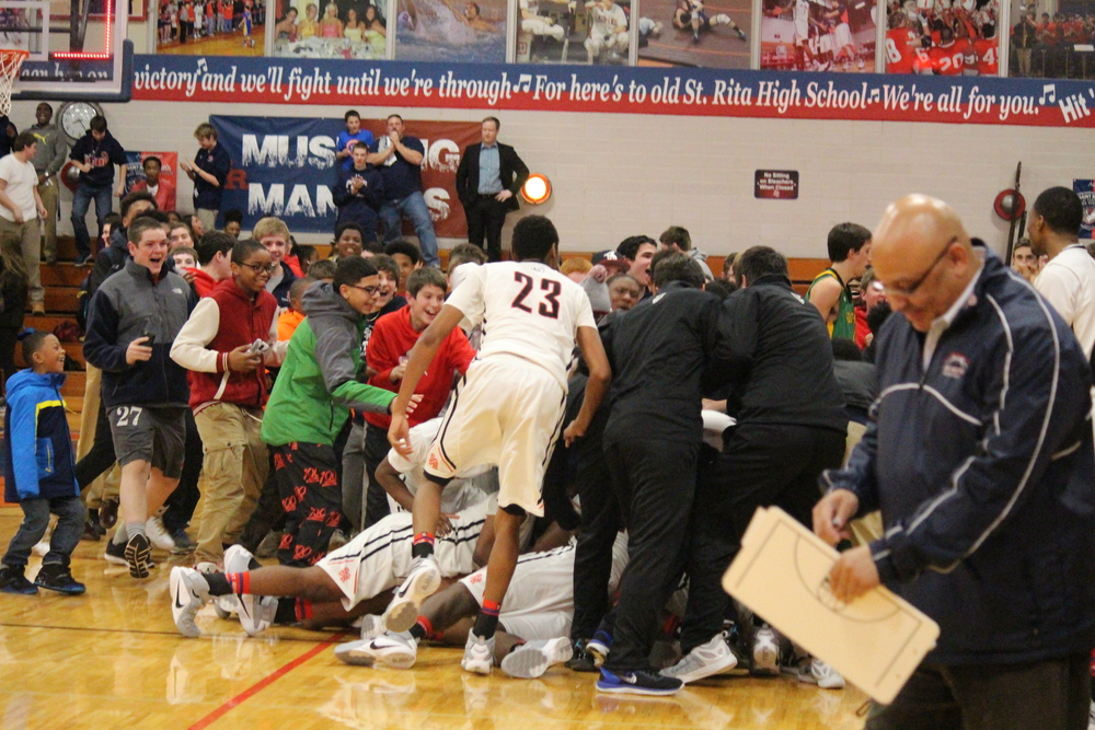 Mustang fans storm the court after Meshach Obafemi's game-winning buzzer beater!