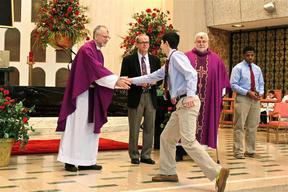 Fr. Steve Curry, O.S.A. congratulates Sophomore Nick Healy