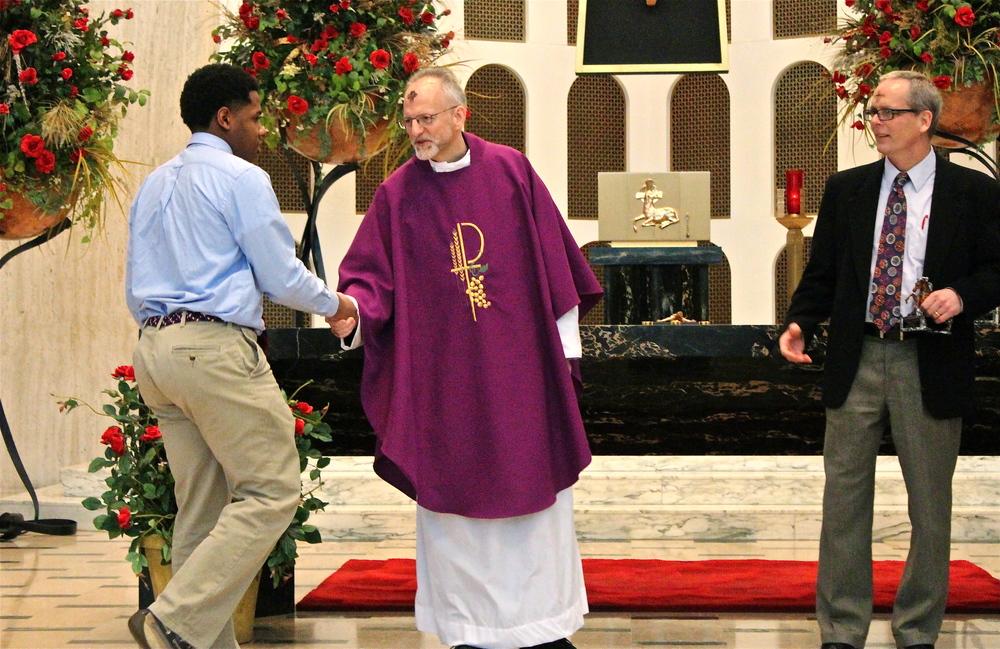 Fr. Steve Curry, O.S.A and Principal Brendan Conroy (Hon.) congratulate Freshman George Western