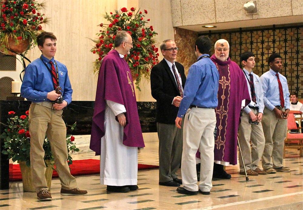 Principal Brendan Conroy (Hon.) congratulates Senior Paul Fernandez