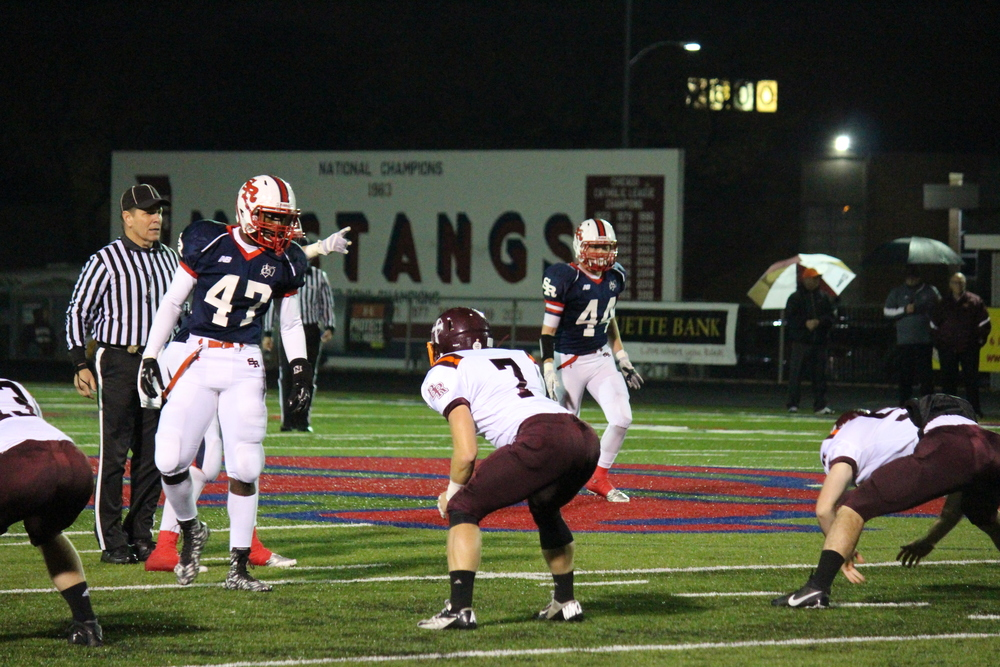 St. Rita Seniors Marc Mondesir (#47) and Liam Kelly (#44)