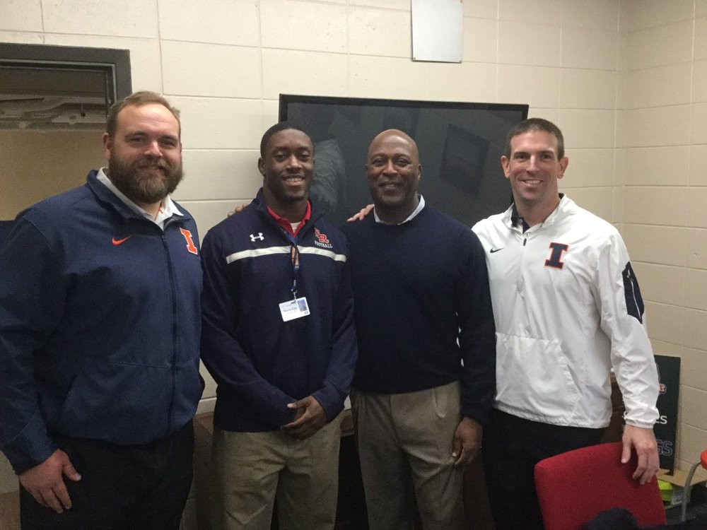 St. Rita's Marc Mondesir with Head Coach Lovie Smith and other U of I coaching staff members