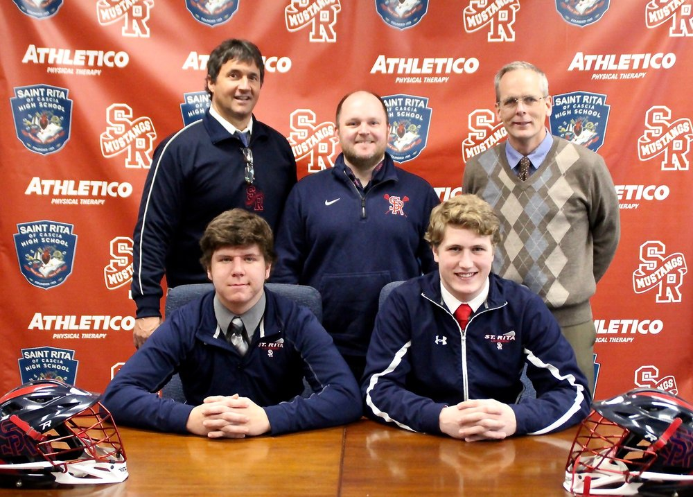 Front row: St. Rita Seniors Matt McGury and Danny Lawler. Back Row: President Mike Zunica, Lacrosse Head Coach Jim Juchcinski '97 and Principal Brendan Conroy