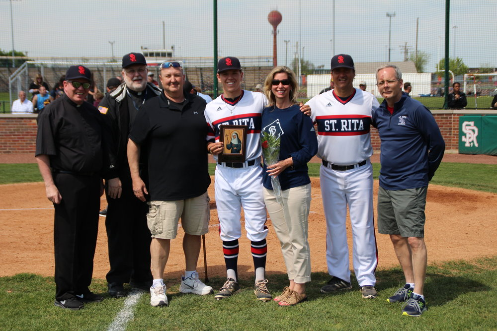 St. Rita senior Steven Washilewski (center)