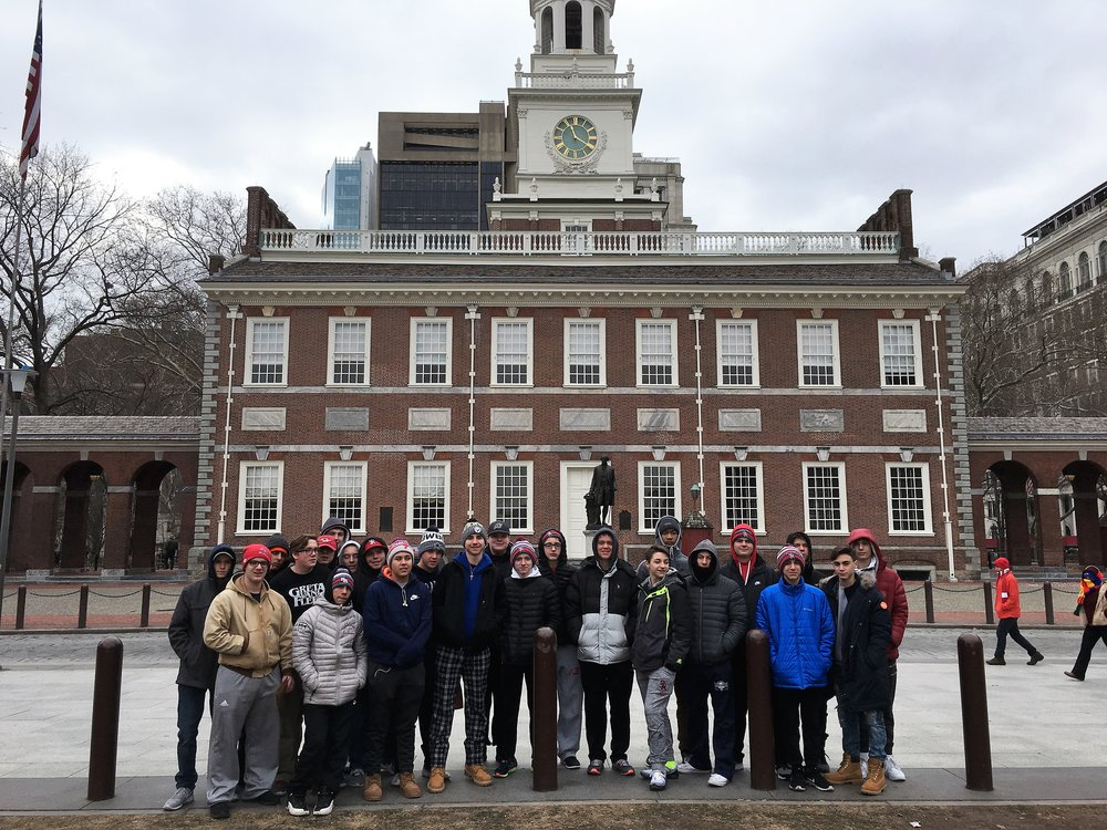 The students visit Independence Hall in Philadelphia, PA as they examine the origins of the American Revolution. The students also visited the Museum of the American Revolution, the Liberty Bell, Ben Franklin's home and Franklin's grave as well as the National Constitution Center. The students also got to experience a true Philly Cheesesteak - the culinary highlight of the trip!