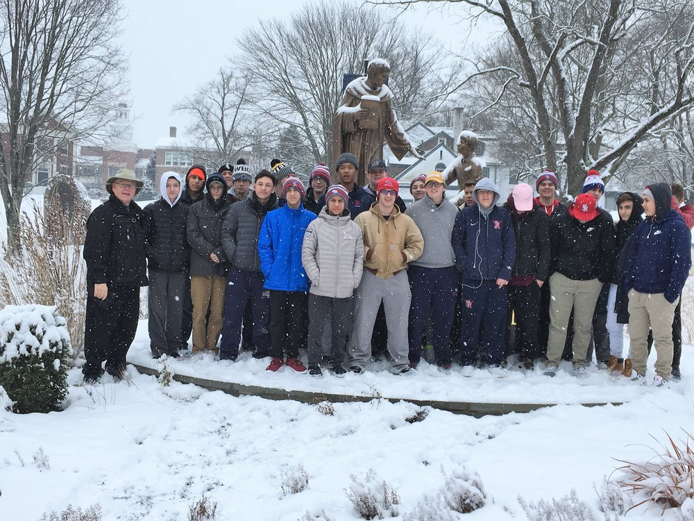 The students visit Malvern Prep outside of Philadelphia during a snow storm.  The students are pictured with Fr. Donald Reilly, OSA, Head of School.