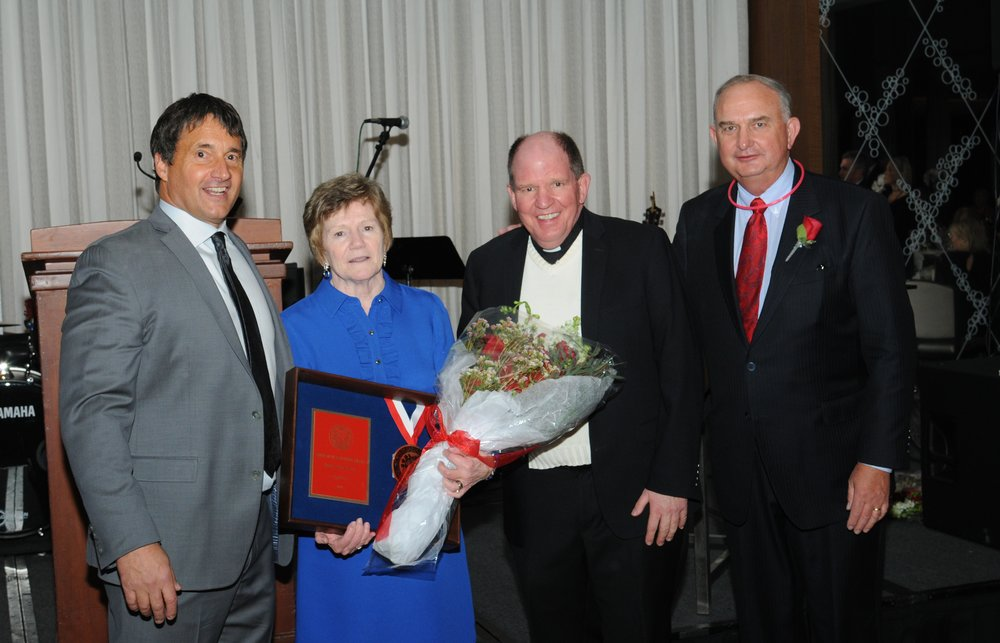 L to R: St. Rita President, Mike Zunica, Crest of St. Augustine Award Winner Sally Deenihan, Head of School, Father Paul Galetto, O.S.A. and Chairman of the Board, Ernie Mrozek '71