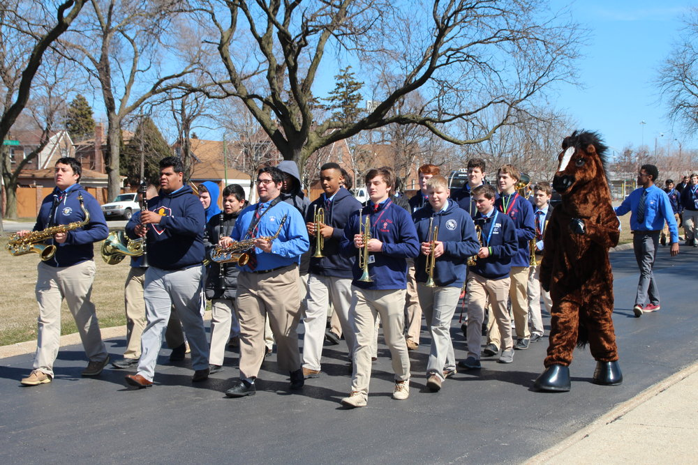 The Marching Mustangs lead the student body out to the groundbreaking ceremony.