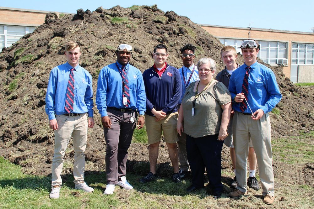 "Mrs. Krystof and AP Chemistry class in front of the ""Mole Hill"" for the Mrozek Family Fitness Center."