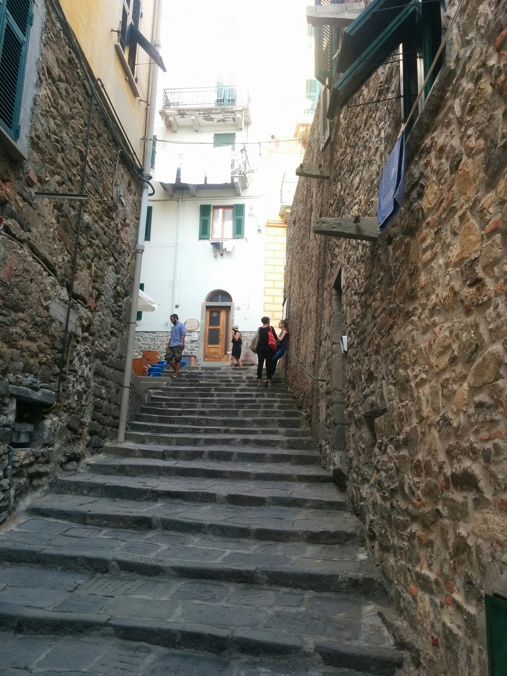 Stairs, stairs, everywhere. These led up to our airbnb. Our room is on the 2nd floor with green shutters and our clean (sink-washed) laundry drying in the wind.