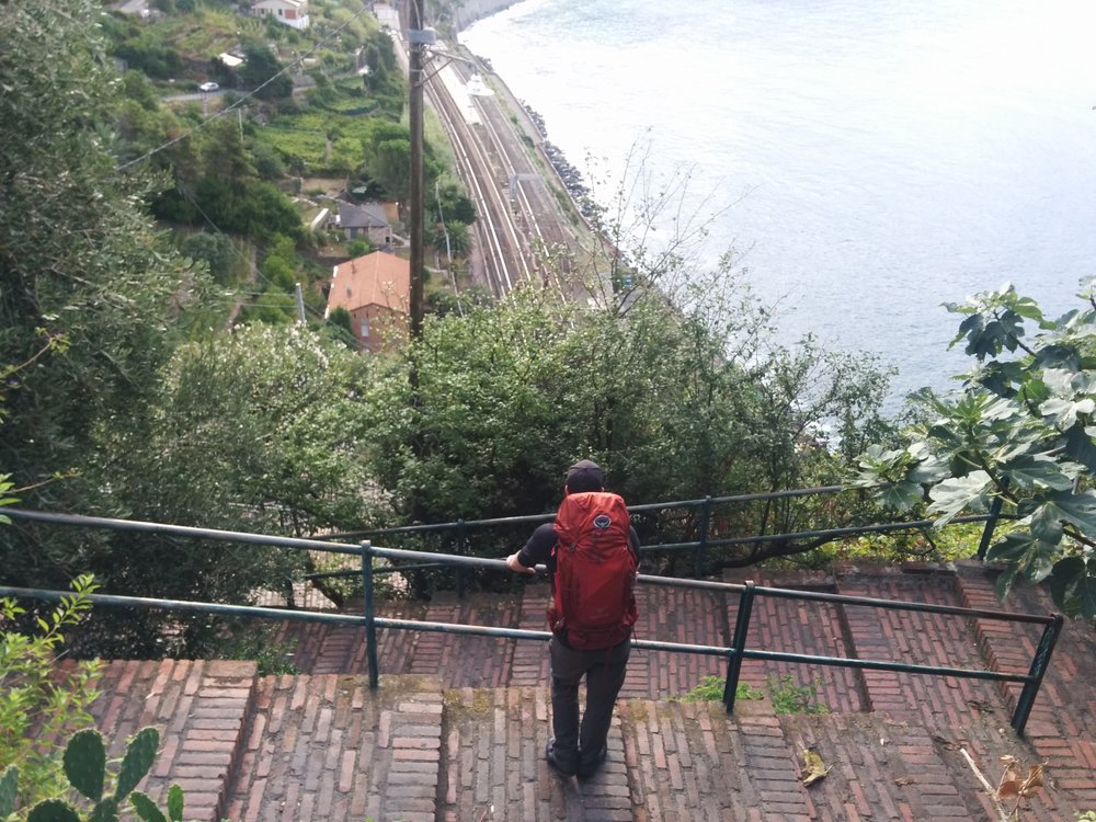On the road again! Nick pausing to enjoy the view as we climb down the 400 stairs on our way to  Naples.