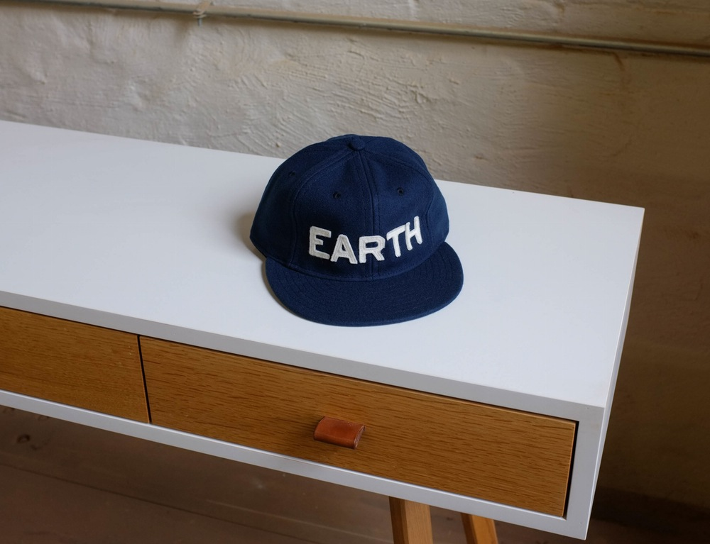 "KC Co's Earth Hat: ""With the world being small enough as it is, how bout we all join together to play on the same team - our favorite team: EARTH"""