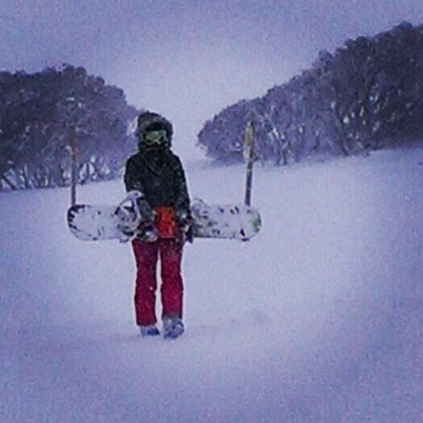 The lone #snowboarding ranger. Trekking down One Tree Hill.  (at Mount Hotham - The Orchid)