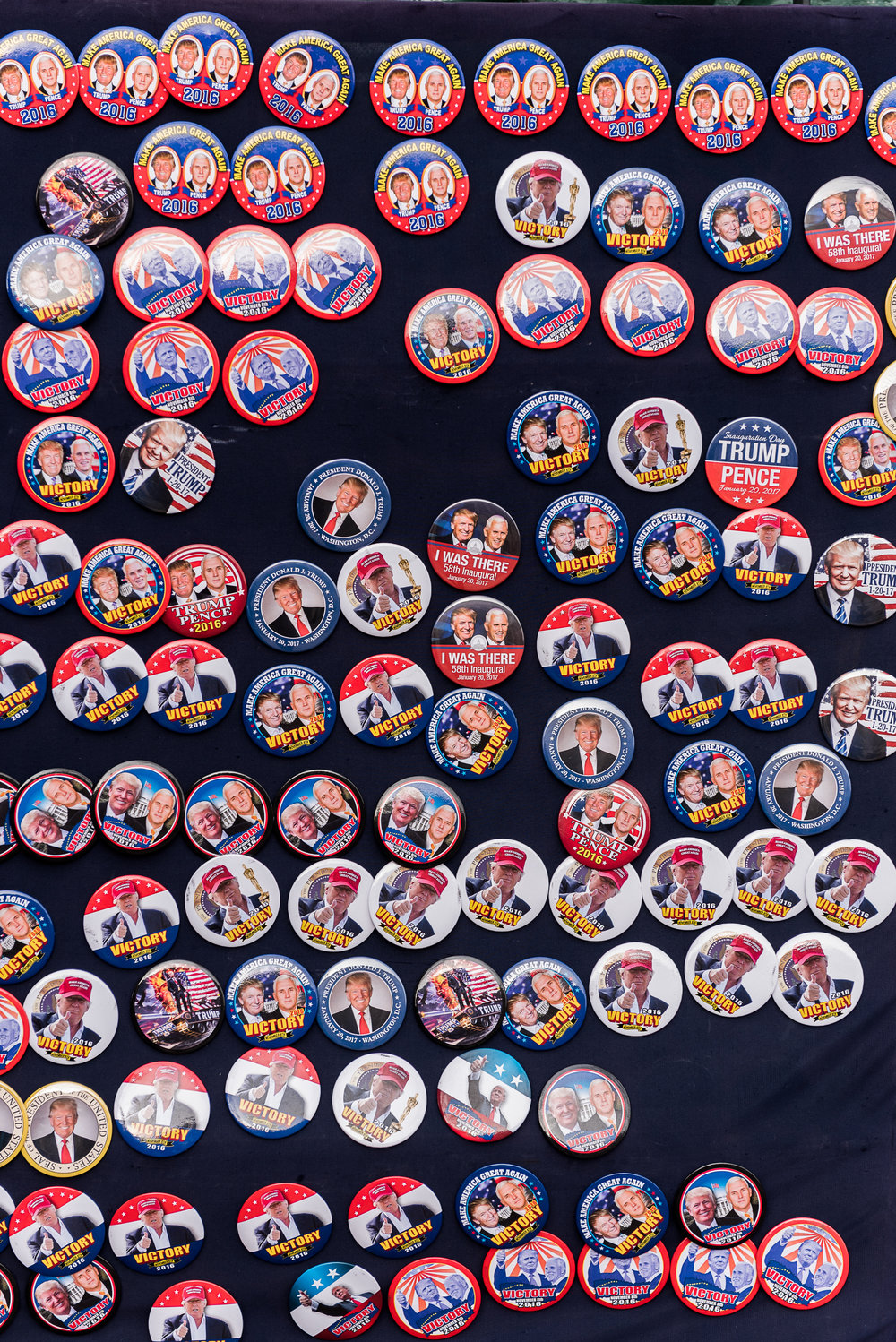 Inauguration buttons sit on display for people to purchase, Thursday, January 19, 2017.
