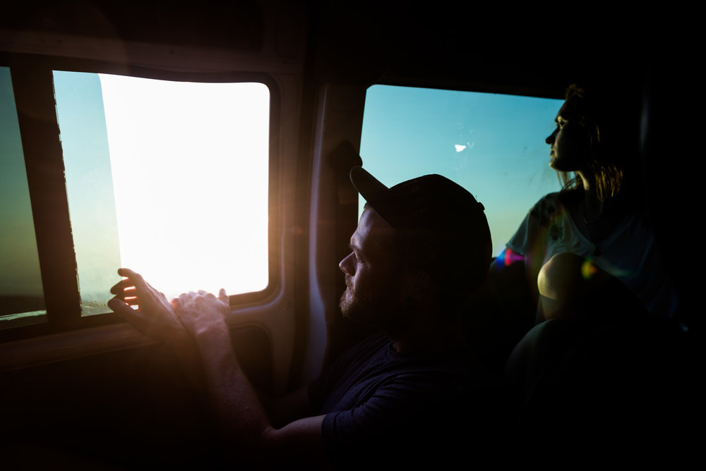 Will Taylor (center) and Annie Hight look out of our van's windows as we depart Mount Olympous late one afternoon on Lesvos, Greece.