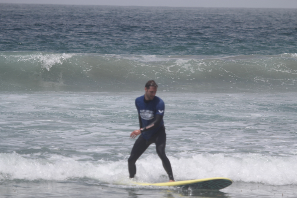 Surfing! Now, you don't need to do this to stay active! The beach is PRETTY LONG....just start walking down it!!
