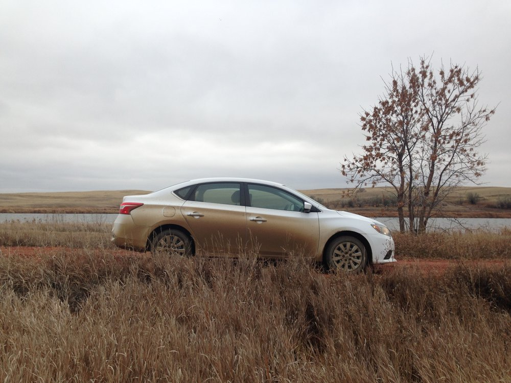 After six weeks of driving gravel roads my rental car started to blend in with the landscape!