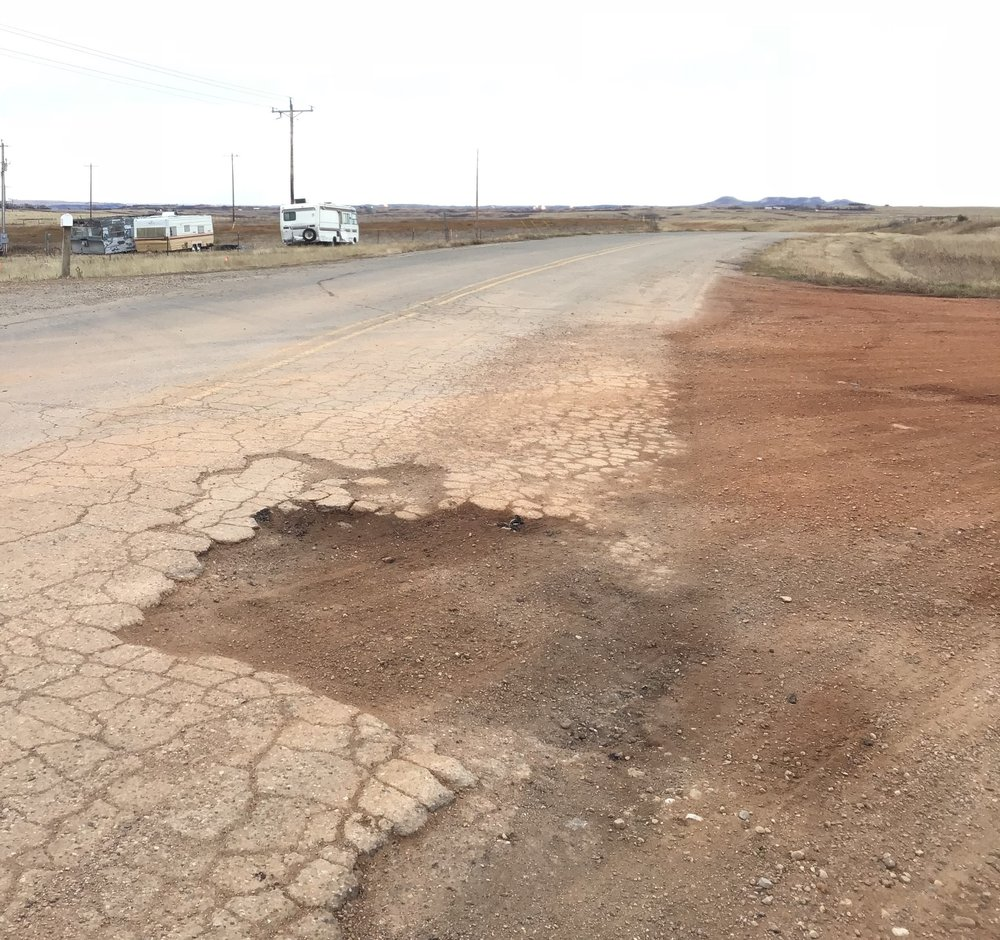 UOG development involves trucks that are often so heavy they have to apply for overweight load permits from the state and/or local municipalities. This picture illustrates the wear and tear that heavy traffic can have on roads.
