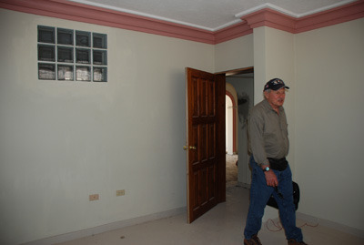 Frank walks around one of the future classrooms of the COHP.