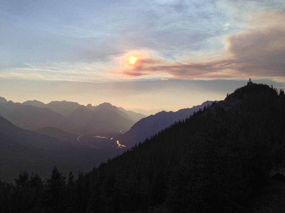 ...a beautiful shot of the sun beginning to set from the summitof Sulpher Mountain, Banff, AB.