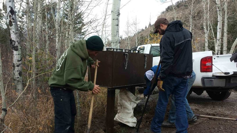 Keeping bears wild and people safe. GYC Wildlife Program Coordinator Chris Colligan (center, black jacket) works with the Bridger-Teton Wilderness Crew and the Teton Conservation District to install a bear box in a public campground southeast of Grand Teton National Park. (Photo GYC.)