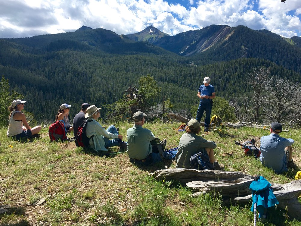 GYC's Peter Bennett (standing) tells the group about how an unlikely coalition of conservationists and loggers protected South Cottonwood in the 1980s. (Photo GYC.)
