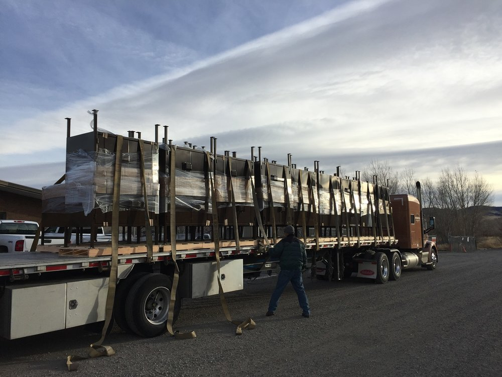 Unloading bear boxes to be installed in Montana's Custer-Gallatin National Forest in 2018. Next year is the final year of our five-year partnership with the Forest Service to bear-proof every campground in Greater Yellowstone. (Photo Forest Service.)