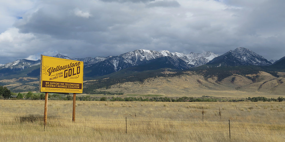 This photo from The Drake magazine's Winter 2017 issue shows a billboard supporting the fight against two proposed gold mines at Yellowstone's gateway. (Photo courtesy Jesse Robbins.)
