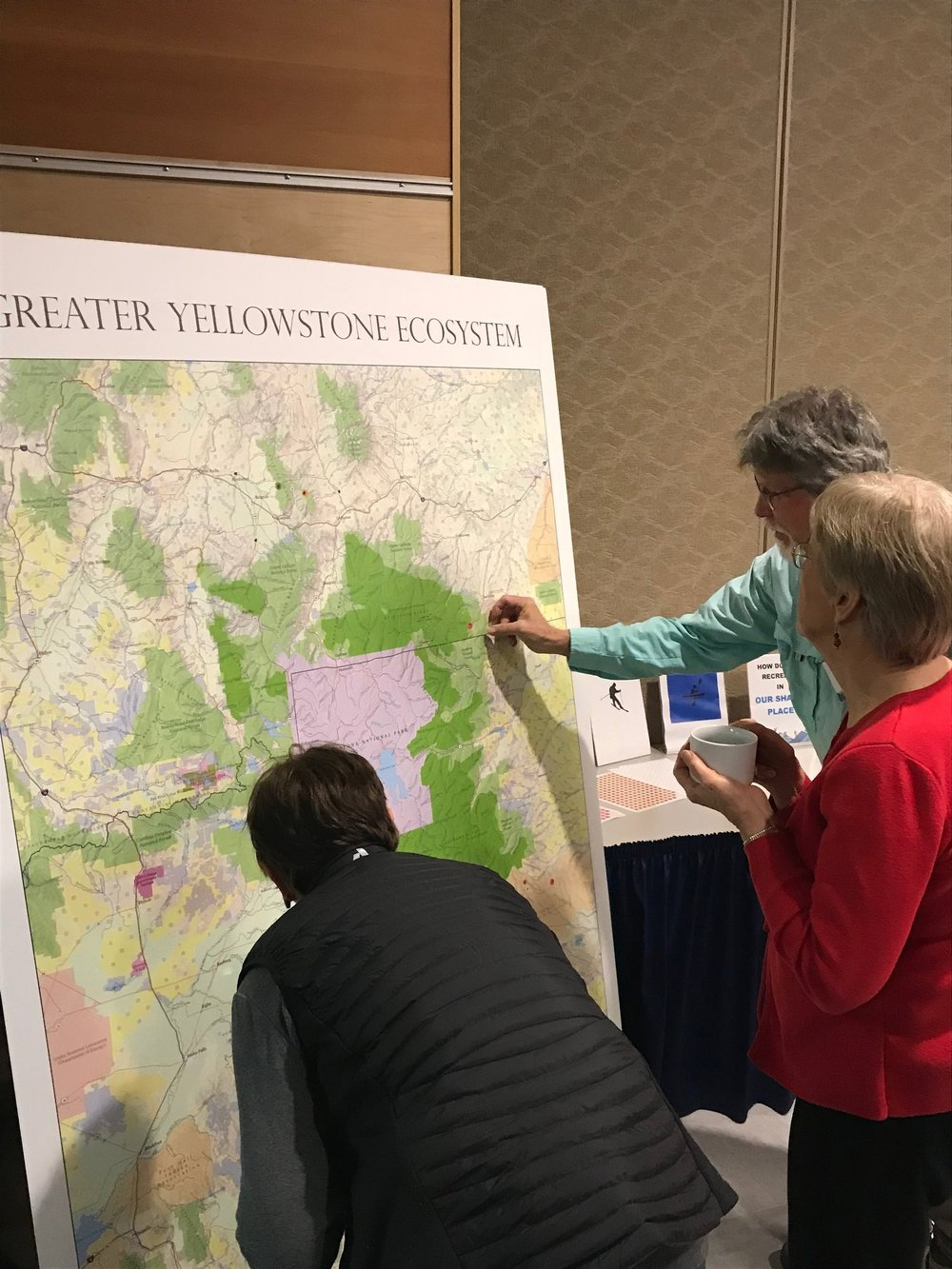 On Monday and Tuesday, symposium attendees at MSU placed activity stickers on a map of the Greater Yellowstone Ecosystem to denote where they enjoy recreating. (Photo: GYC.)