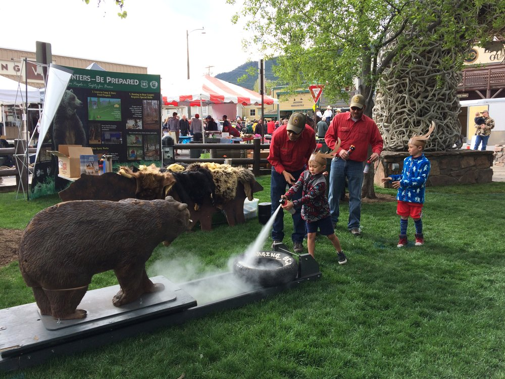 Quick draw practice with inert bear spray at the 2018 ElkFest in Jackson, Wyoming.