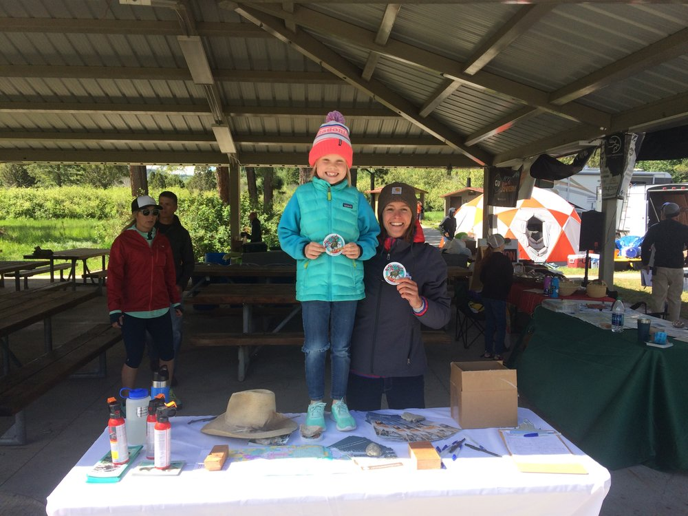 Allison Michalski, GYC's Idaho Conservation Associate, hanging with a young race participant during the Scout Mountain Ultras. (Photo GYC.)