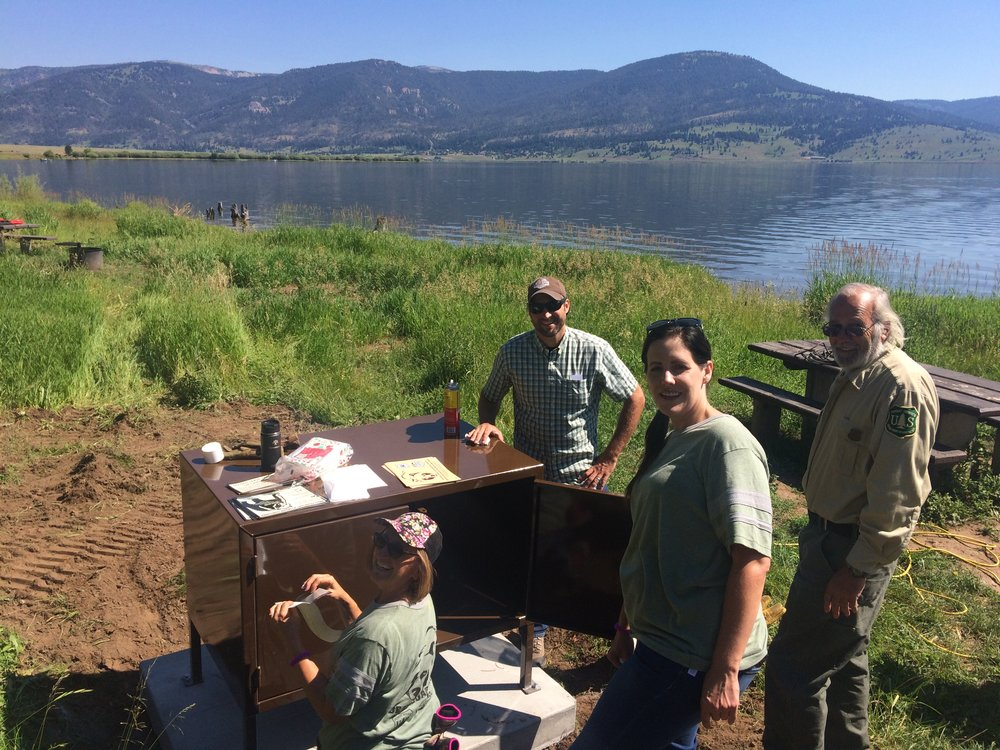 Installing a bear box at the Spring Creek campground on Hebgen Lake. (Photo GYC.)